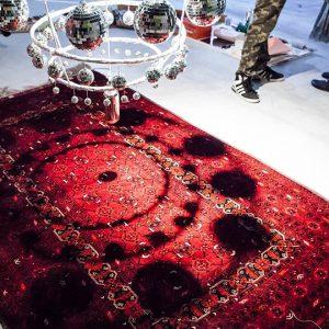 Persian rug under chandelier of disco balls