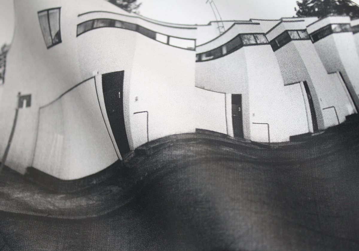 Warped view of housing complex in black and white
