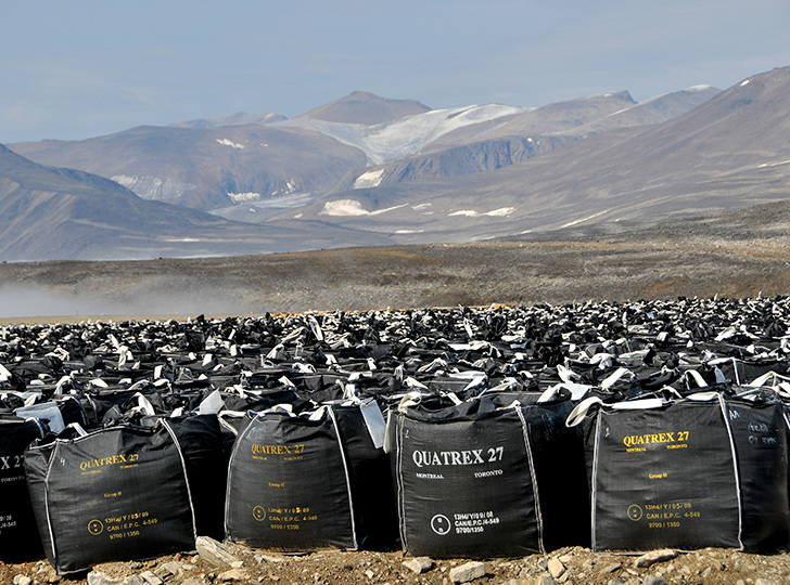 Hundreds of black bags of soil in the valley of Cape Dyer
