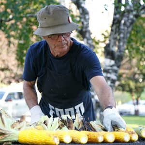 Artist Ron Benner roasting corn on the cob