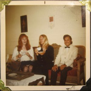 Polaroid photo of three friends sat on a couch