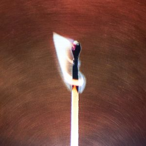 Lit match with open flame
