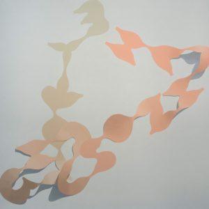 pastel orange and beige paper cutouts