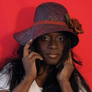 image of a person wearing a straw purple hat