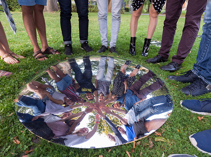 Students joining hands over Wa Wa installation on campus
