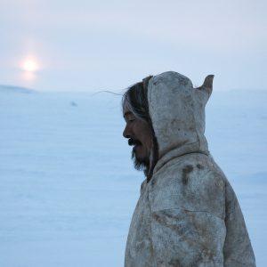 Man in coat on tundra
