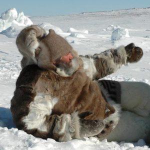 Man in fur jacket on tundra