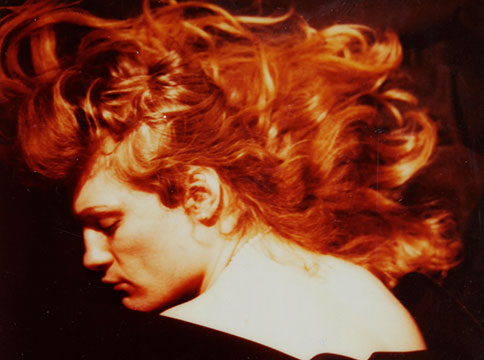 Lorenza Böttner facing left surrounded by her fiery red hair.
