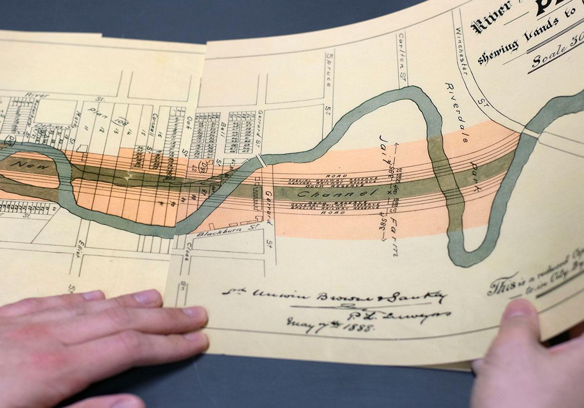 Artist holding image of River Don Straightening Plan, 1888