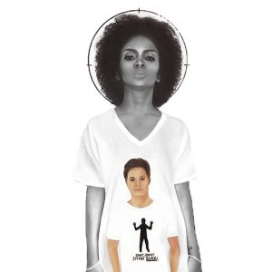 "black woman wearing a shirt with an image of a white man wearing a shirt with a black figure with the words ""DON'T SHOOT I'M NOT BLACK!""."