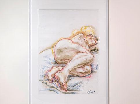 Pastel drawing of figure sleeping on blue bed