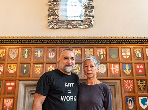 Rebecca Belmore and OSvaldo Yero in front of silver mirror in great hall