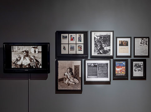West wall in gallery with images featuring Canadian pacific ad