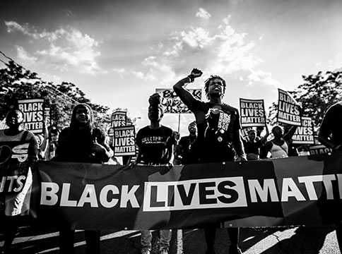A group of people in a Black Lives Matter protest.