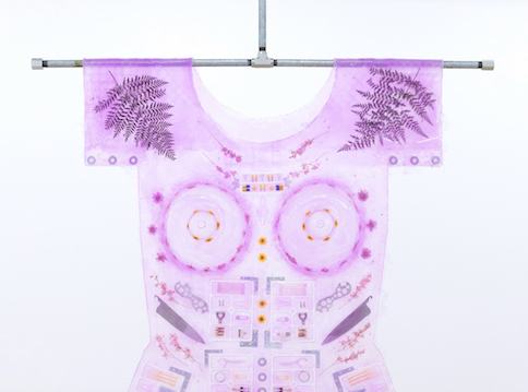 Shirt made from purple silicon with objects pressed into it