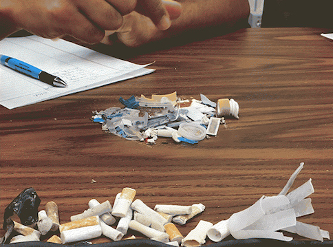Photo of waste such as cigarette butts being sorted by members of Synthetic Collective