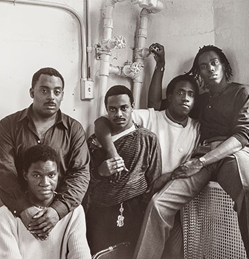 A photograph of five Black men.