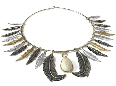 Metal necklace with metallic feathers and ivory pendant