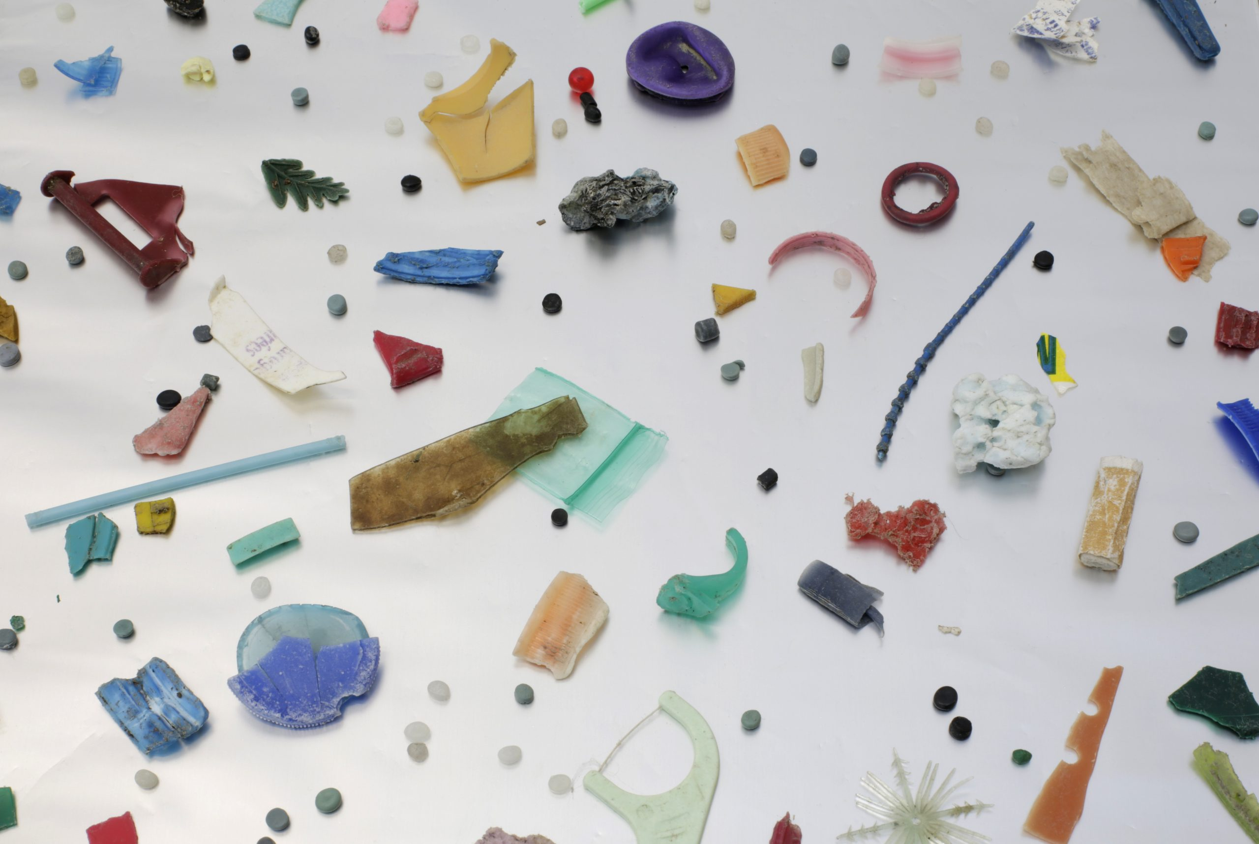 various pieces of plastic objects against white surface
