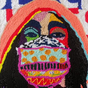 tapestry of woman with multi-patterned mask against black lives matter