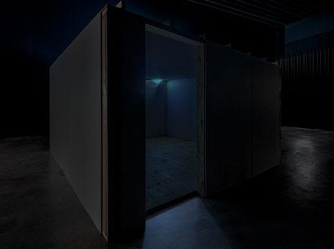 Dark room with no door installed in larger dark room